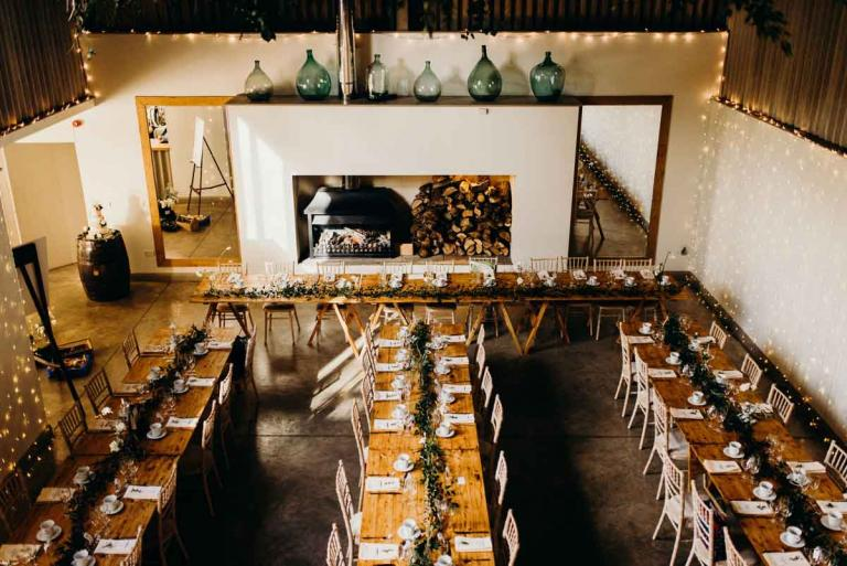 Long wedding tables in the grain store